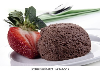chocolate mousse and organic strawberry on a plate
