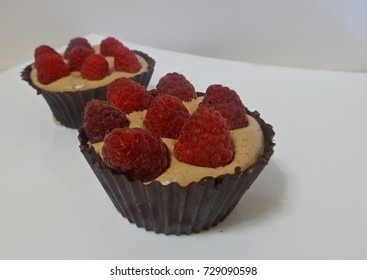 Chocolate mousse with raspberries in a basket of chocolate