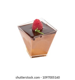 Chocolate mousse whipped dessert with chocolate sauce, raspberry and rosemary in portion transparent glass isolated on white background