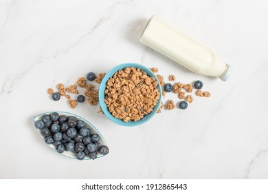 Chocolate Muesli Bar with Blueberries and Mint Leaf. chocolate granola with blueberries