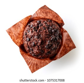 Chocolate muffin in brown paper isolated on white background, top view