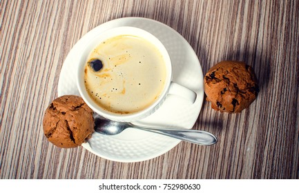 Chocolate muffin and coffee is ideal for a good breakfast.