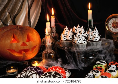 Chocolate muffin meringues with meringues on the table in honor of Halloween
