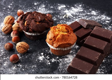 Chocolate muffin and nut muffin, homemade bakery on dark background