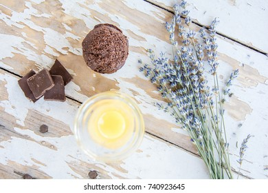 Chocolate muffin with orange juice beside lavender flower