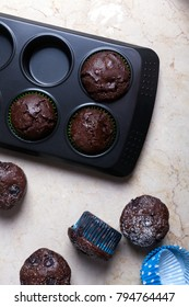 Chocolate muffins - american sweet food. Top view. White background
