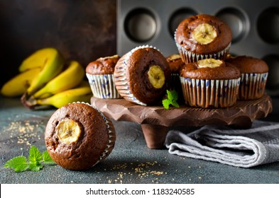 Chocolate muffins with banana on concrete background. Fresh homemade pastry
