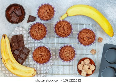 Chocolate muffins with banana and sugar crust on the cooking grill. Fresh homemade pastry. Selective focus, top view