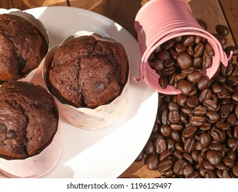 Chocolate muffins and coffee beans from a gourmet cafe