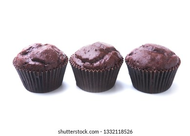 chocolate muffins, cupcake with chocolate chips isolated on white background. Delicious homemade muffins.