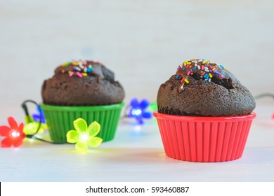 Chocolate muffins cupcakes on a white table background / Selective focus