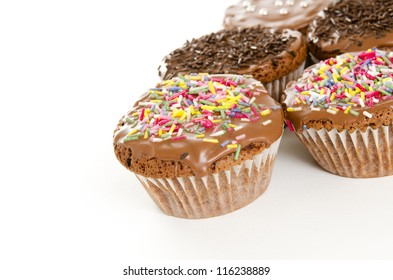 chocolate muffins on white background