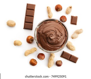 Chocolate nut spread in a bowl with hazelnuts and peanuts, top view on white background