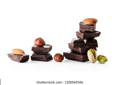 Chocolate and nuts against white background