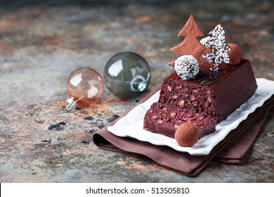 Chocolate and nuts Christmas cake, selective focus