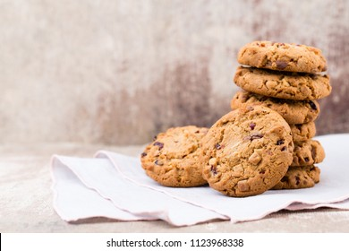 Chocolate oatmeal chip cookies on the rustic wooden table.