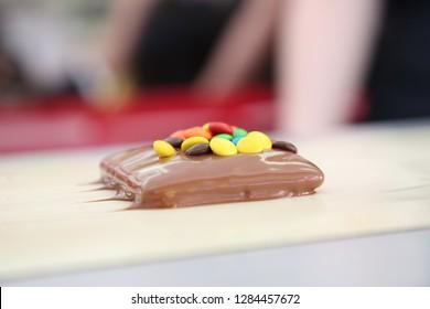 Chocolate on conveyor belt
