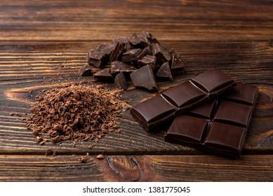 Chocolate on dark wooden background.