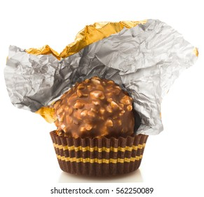 chocolate with an open gold candy wrapper, on a white background, isolated