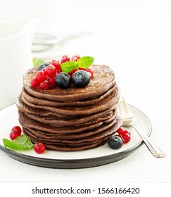 Chocolate pancakes with berries. selective focus.