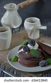 Chocolate pancakes with ice cream, blackberries and mint. coffee. breakfast