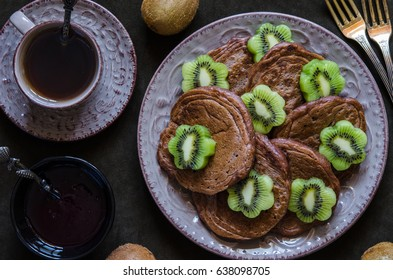 Chocolate pancakes with vegan with kiwi for breakfast