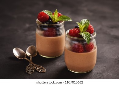 Chocolate pannacotta with raspberries and blueberries.