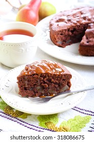 Chocolate pear cake with caramel topping on plate