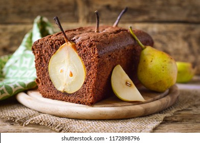 Chocolate pie (cake) with whole pears