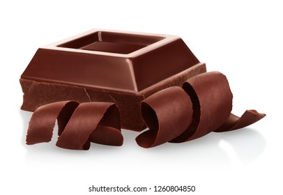 Chocolate pieces with chocolate shavings on white background