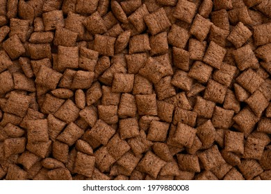 chocolate pillows background texture, brown choco cereal pads pattern, crispy corn flakes wallpaper, healthy sweet snack for breakfast mockup with copy space top view