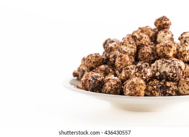 Chocolate popcorn on white background