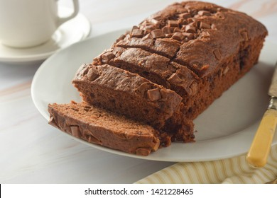 Chocolate pound cake. Homemade dark chocolate pastry for breakfast or dessert, light background