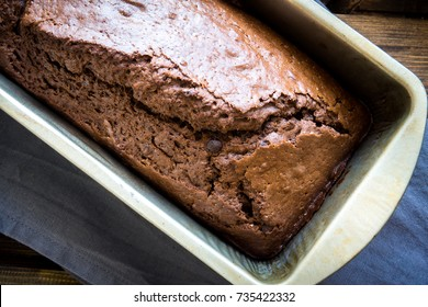 Chocolate Pound Cake with Rum and Chocolate Drops in baking dish. Homemade dark chocolate pastry for breakfast or dessert.