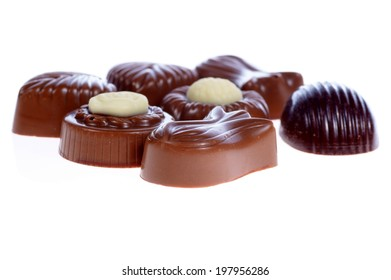 chocolate pralines on white background. Delicious dark and milk chocolate pralines.