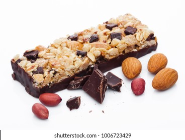 Chocolate protein cereal energy bar with almonds and peanuts white background