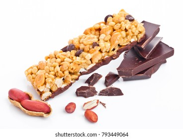 Chocolate protein cereal energy bar with peanuts on white background