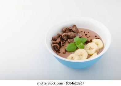 Chocolate pudding, banana and herbs in, food photography, product photo