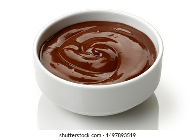 Chocolate pudding in a bowl isolated on white background