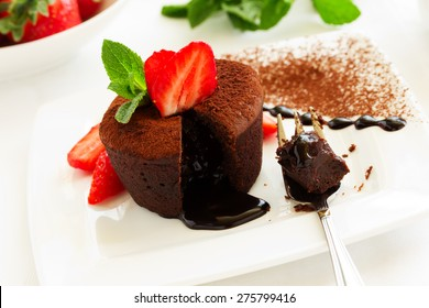 chocolate pudding with fudge center with strawberries,