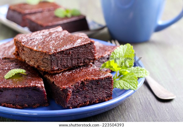 Chocolate and pumpkin brownie slices, selective focus