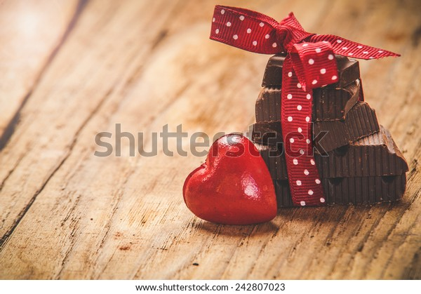 Chocolate with ribbon and heart on St. Valentine's day love.