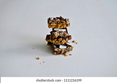 Chocolate, rolled oats and peanut butter energy bars on white background