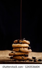 Chocolate sauce dripping over tasty chocolatechip cookies