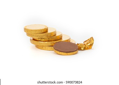 chocolate shaped like coins in gold foil sheet isolated on white background