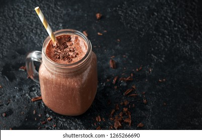 Chocolate smoothie in jars for healthy breakfast