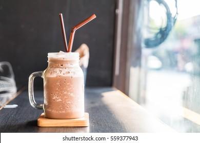 Chocolate smoothie (milkshake) with jar in cafe