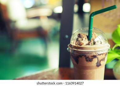 Chocolate smoothie in takeaway cup on table. selective focus.