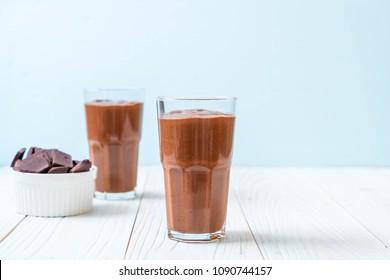 chocolate smoothies milkshake on wood background