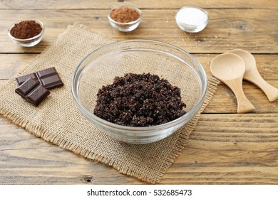 chocolate spa- homemade face and body scrub in a glass on wood background